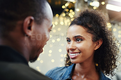 Buy stock photo Cropped shot of a happy young couple out on a date