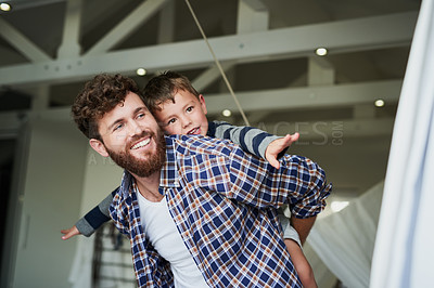 Buy stock photo Cropped shot of an adorable little boy on his dad's back with his arm's stretched out