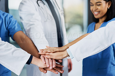 Buy stock photo Closeup shot of a group of medical practitioners joining their hands together in a huddle