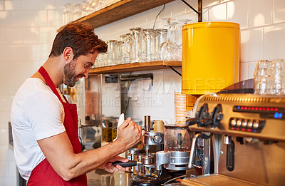 Buy stock photo Shot of a barista busy with a coffee machine