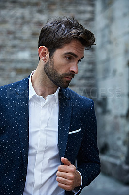 Buy stock photo Cropped shot of a handsome young businessman standing in an urban alleyway