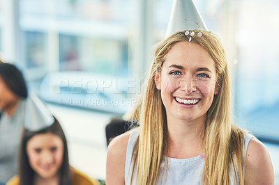 Buy stock photo Cropped portrait of an attractive young woman wearing a party hat while celebrating a birthday with her friends