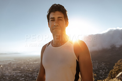 Buy stock photo Cropped portrait of a handsome young man out for a run in the mountains