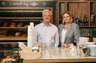 Buy stock photo Cropped portrait of a mature couple standing in their self-owned coffee shop