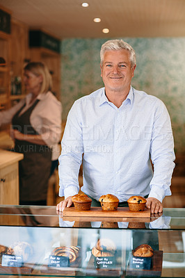 Buy stock photo Cropped portrait of a mature male entrepreneur standing behind the counter of his self-owned coffee shop