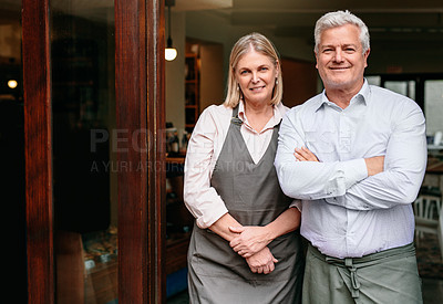 Buy stock photo Cropped portrait of a mature couple standing in the doorway of their self-owned coffee shop