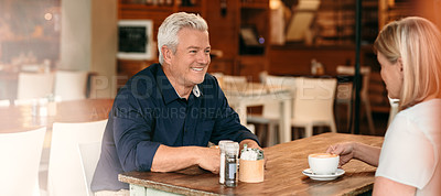 Buy stock photo Cropped shot of a mature couple enjoying their date in a coffee shop