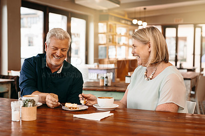 Buy stock photo Cropped shot of an affectionate mature couple enjoying their date in a coffee shop