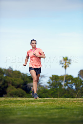 Buy stock photo Shot of a young attractive woman running outside
