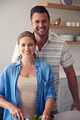 Buy stock photo Portrait of a married couple making food together in the kitchen at home