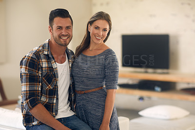 Buy stock photo Portrait of a young married couple spending the day at home