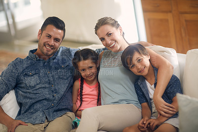 Buy stock photo Shot of a family of four spending quality time together at home