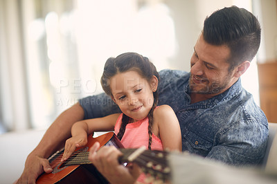 Buy stock photo Shot of a father and daughter spending time together at home