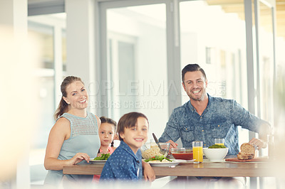 Buy stock photo Shot of a family of four having lunch at home