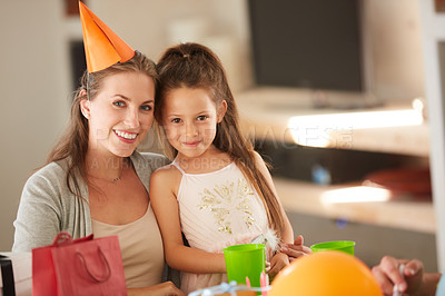 Buy stock photo Shot of a mother and daughter together at a birthday party
