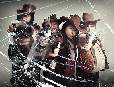 Buy stock photo Studio shot of a band of outlaws standing with their pistols pointed after shooting through your glass screen