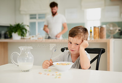 Buy stock photo Shot of a little boy refusing to eat his breakfast at home
