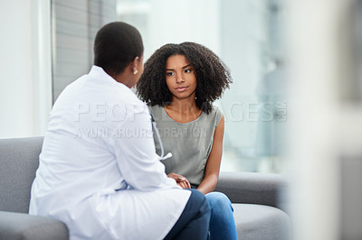 Buy stock photo Shot of a young woman having a consultation with a doctor