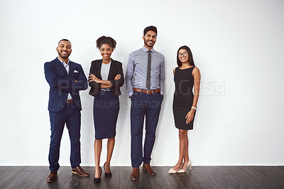 Buy stock photo Studio portrait of a group of confident young businesspeople posing against a gray background