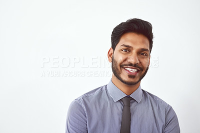 Buy stock photo Studio shot of a confident young businessman posing against a gray background