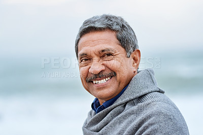 Buy stock photo Portrait of a handsome senior man enjoying a day on the beach