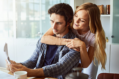Buy stock photo Cropped shot of a young attractive couple at home