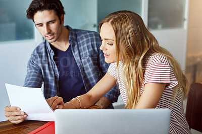 Buy stock photo Cropped shot of an affectionate young couple planning their home budget in the living room
