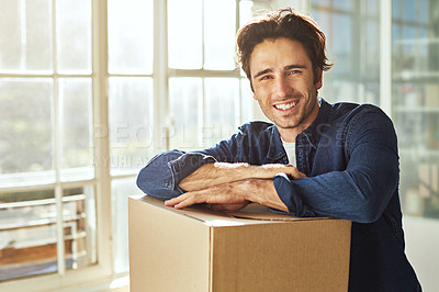 Buy stock photo Shot of a young man moving into his new home