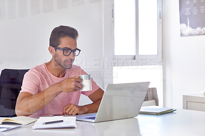 Buy stock photo Cropped shot of a young designer working on his laptop