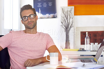 Buy stock photo Cropped shot of a young businessman sitting at his desk