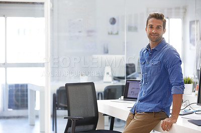 Buy stock photo Shot of a confident young man in his office