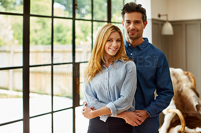 Buy stock photo Portrait of an affectionate couple bonding together at home
