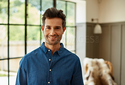 Buy stock photo Portrait of a young man standing in the living room at home