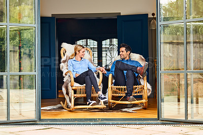 Buy stock photo Shot of a couple relaxing together on rocking chairs at home