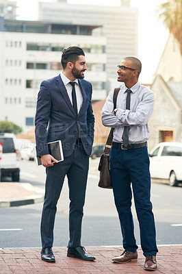 Buy stock photo Shot of two businessmen having a discussion while out in the city