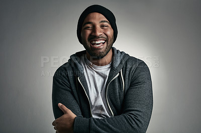 Buy stock photo Cropped portrait of a young homeless man in raggedy clothing posing against a grey background
