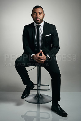 Buy stock photo Full length portrait of a handsome young businessman posing against a gray background