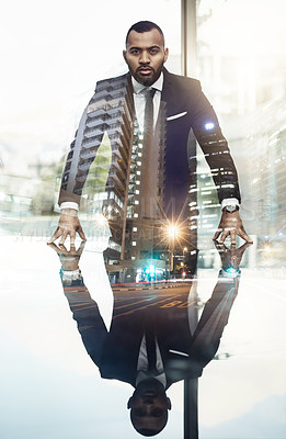 Buy stock photo Cropped portrait of a handsome and confident young businessman superimposed against a cityscape
