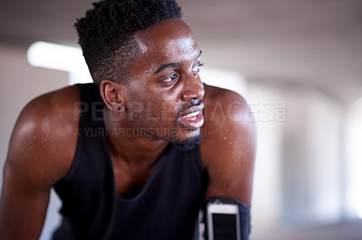 Buy stock photo Cropped shot of a handsome and athletic young man exercising out in the city