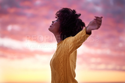 Buy stock photo Cropped shot of a young beautiful woman spending the day at the beach