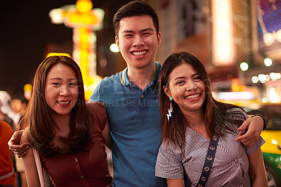 Buy stock photo Shot of a group of young friends enjoying a night out in the city