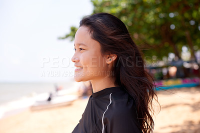 Buy stock photo Cropped shot of an attractive young woman taking in the views at the beach