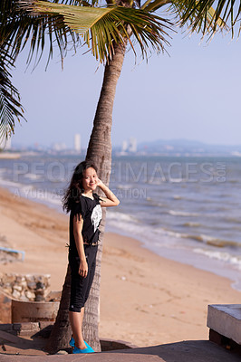 Buy stock photo Full length portrait of an attractive young woman enjoying a day at the beach