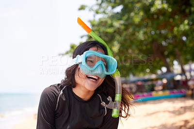 Buy stock photo Cropped shot of an attractive young woman wearing her snorkelling gear at the beach