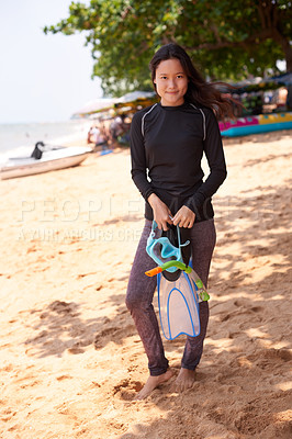 Buy stock photo Full length portrait of an attractive young woman standing with her snorkelling gear at the beach
