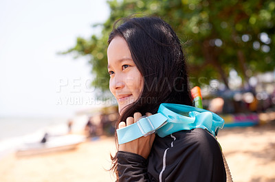 Buy stock photo Cropped sho of an attractive young woman wearing her snorkelling gear at the beach