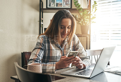 Buy stock photo Cropped shot of a young woman using a laptop in the morning at home