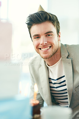 Buy stock photo Cropped shot of a handsome young man celebrating his birthday