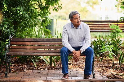 Buy stock photo Shot of a mature man looking thoughtful outdoors