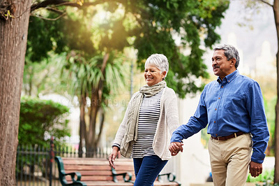 Buy stock photo Shot of a mature couple out for a walk at the park